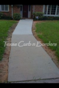 Decorative concrete walkway before image
